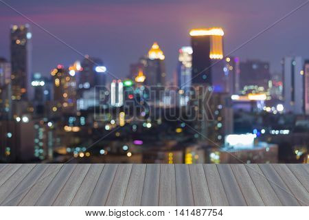 Opening wooden floor, Abstract blurred bokeh lights city background