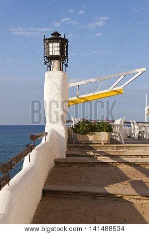 Terrace of a restaurant bar in front the mediterranean sea in Roc de Sant Gaieta Roda de Bera Tarragona Spain.