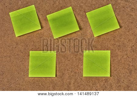 Yellow-green blank paper stickers on the old fibrous cardboard