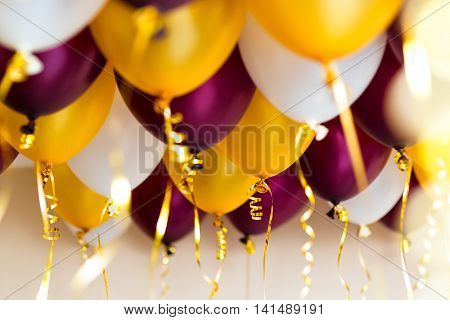 colourful balloons, golden, white, red streamers isolated on white