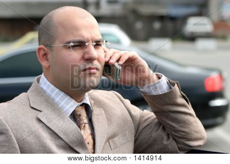 A Businessman Calling By Mobile Phone