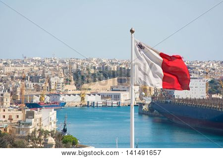 View of a Maltese flag waving in Valletta.