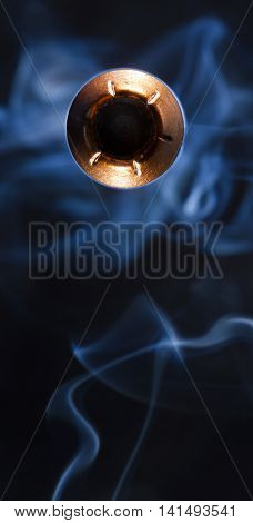 Hollow point bullet that is coming at the camera with smoke