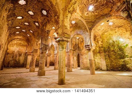 RONDA, SPAIN - OCTOBER 5, 2014: The Arab Public Baths dating from the 11th-12th Centuries. They are considered some of the best preserved baths of their kind on the Iberian Peninsula.