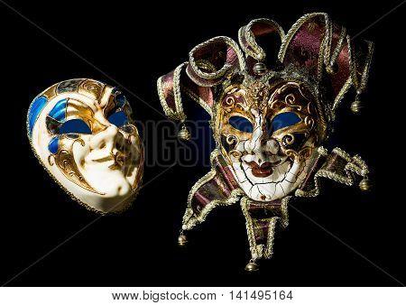 Venetian souvenir masks on black background isolated.