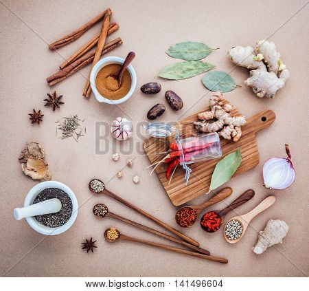 Mixed Spices And Herbs Background Cinnamon Stick And Cinnamon Powder In White Mortar With Star Anise