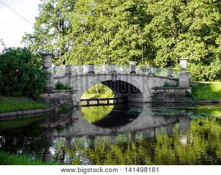 Visconti bridge in Pavlovsk Park St. Petersburg. Historical monument of Russian classicism of the late XVIII - early XIX centuries from the collection of Russian, Western European and ancient art.