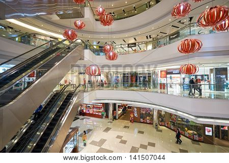 SHENZHEN, CHINA - FEBRUARY 05, 2016: inside of a shopping center in Shenzhen. Shenzhen has excellent shopping choices and offers tourists great shopping opportunities.