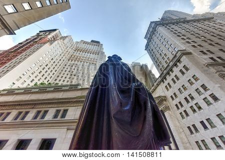 New York City - June 29, 2016: Federal Hall with Washington Statue from behind on Wall Street in Manhattan New York City. Location where George Washington took the oath of office as first President.