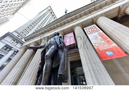 New York City - Jun 29 2016: Facade of the Federal Hall with Washington Statue on the front on Wall Street in Manhattan. Location where George Washington took the oath of office as first President.