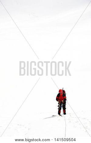Alpinist traversing Mensu Glacier in Altai Mountains, Russian Federation