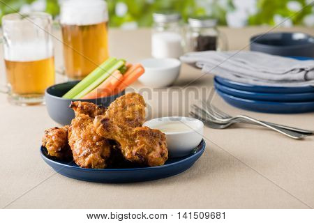 Barbecue Hot Chicken Wings With Beers At Pub Garden