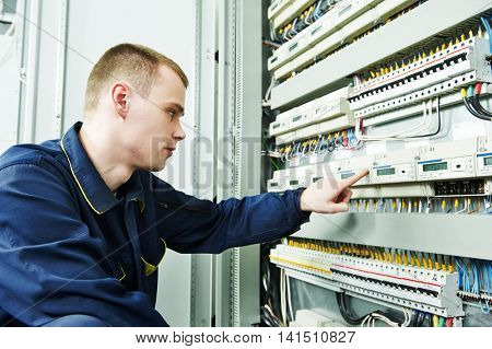 electrician engineer inspector in front of fuseboard