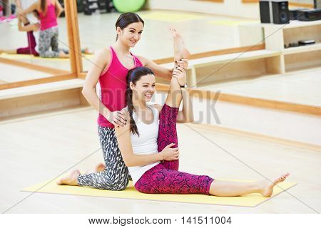 woman with personal trainer instructor doing fitness exercise