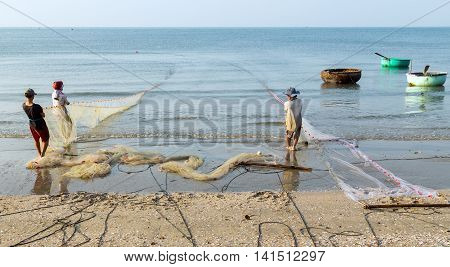 Fishermen Is Pulled Fishes In The Fishing Net