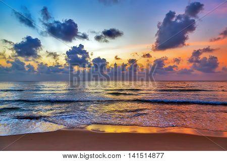 hot tropical sunset sky over sea beach background.
