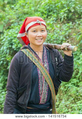 TA PHIN LAO CAI VIETNAM - NOV 21 2014: Woman from Red Dao minority group wearing traditional headdress near Ban Ho village Sapa District Lao Cai Vietnam.
