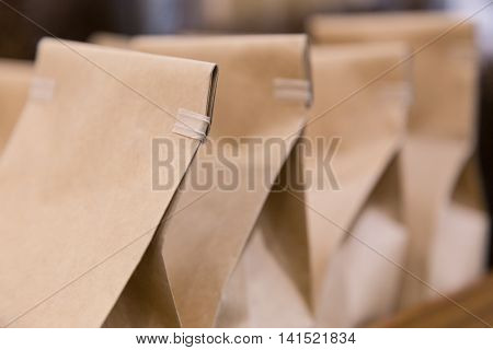 Wrapped paper brown bags selective focus with shallow depth of field