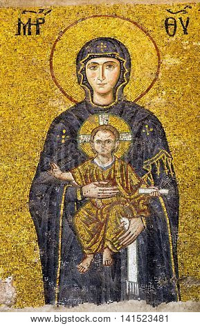 ISTANBUL TURKEY - 1 MAY 2014: The Virgin Mary holding the Christ Child easter Byzantine mosaic Interior Hagia Sophia Aya Sofya museum in Istanbul Turkey