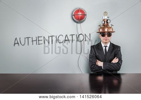Authentication text text with vintage businessman and alert light