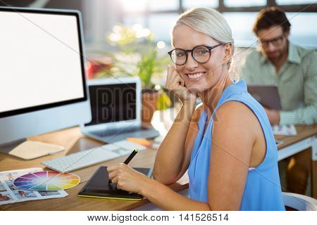 Graphic designer using graphic tablet in office