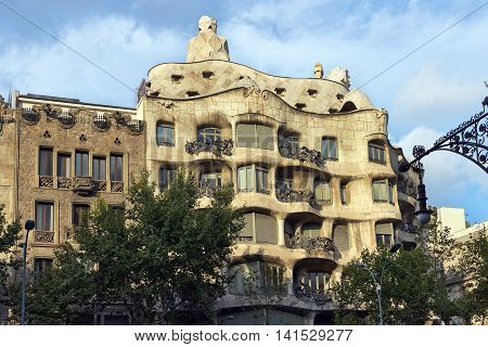 BARCELONA SPAIN - AUGUST 24: Casa Mila with Old Street Torch facade of the house made by the architect Antonio Gaudi on August 24 2012 in Barcelona Spain