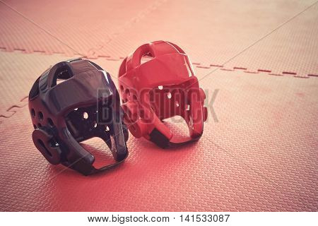 Taekwondo head guard on a training mat in old vintage tone