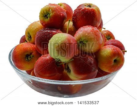 Freshly picked wild apples with water drops in a glass bowl isolated on white background