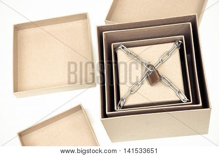 Opening secret boxes with the last one chained and lock / Secret and puzzle concept