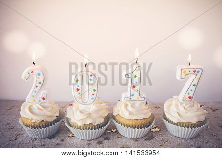 2017 Happy New Year Cupcakes with fairy light toning background