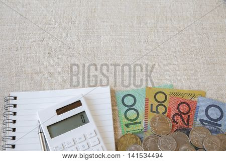 Australian Money, Aud With Calculator, Notebook And Small Money Pouch, Copy Space Background