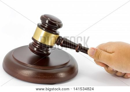 Wooden gavel with sound block and hand