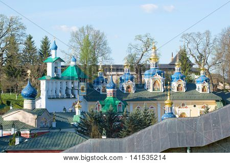 Belfry and domes of the assumption Cathedral of the Holy Dormition Pskovo-Pechersky monastery, morning in may. Pechory, Pskov region, Russia