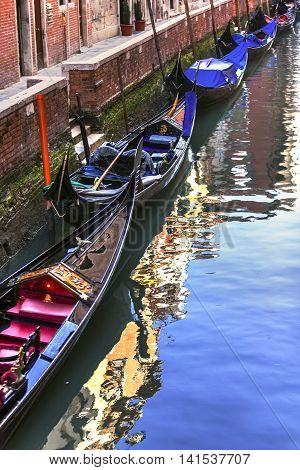 Gondolas Waiting In Canal, Venice, Italy