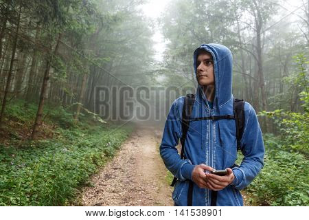 Teenage Hiker Using Gps Outdoor