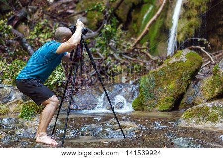Professional Landscape Photographer Shooting A Waterfall