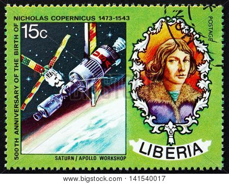 LIBERIA - CIRCA 1973: a stamp printed in Liberia shows Nicolaus Copernicus Polish Astronomer Saturn and Apollo Spacecraft circa 1973