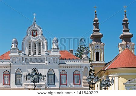 TIMISOARA ROMANIA - AUGUST 5 2016: Orthodox bishop's residence and serbian church located in Union Square in Timisoara Romania.