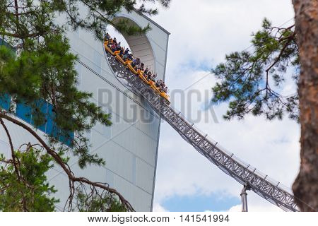 TOKYO JAPAN - 19 JULY 2016 - People enjoy the Thunder Dolphin ride at Tokyo Dome Amusement Park in Tokyo Japan on July 19 2016.