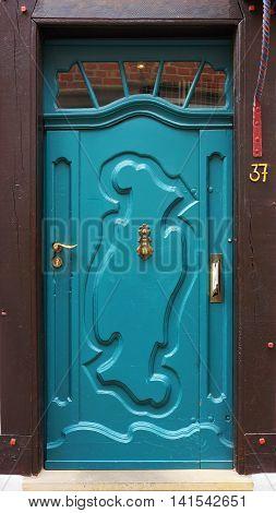 Front door of a medieval building in Bremen Germany.