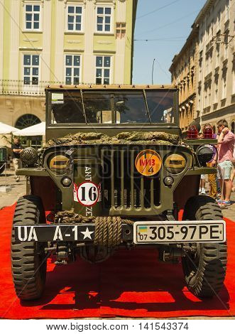 Lviv Ukraine -- June 12 2015: The restored car JEEP WILLYS (Millitary Police) is demonstrated by Leopolis Grand Com at Market Square in Lviv Ukraine