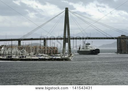 Car passenger ferry under harbour suspension bridge entering Stavanger Harbour, Stavanger, Rogaland, Norway