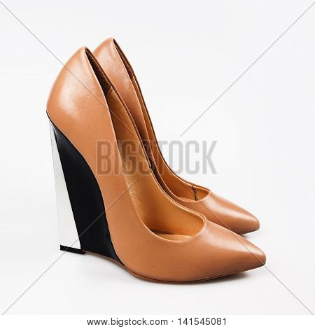 summer female beige shoes in grey background