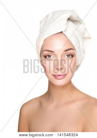 Portrait of beautiful girl touching her face with a towel on her head