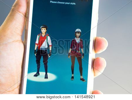 Rayong, Thailand - August 7, 2016: Apple user select a young man character on Pokemon Go app, a mobile game developed by Niantic for iOS and Android devices -  Select focus