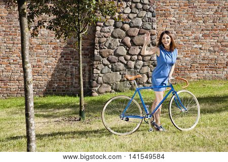 Cheerful Girl On The Bike Ride