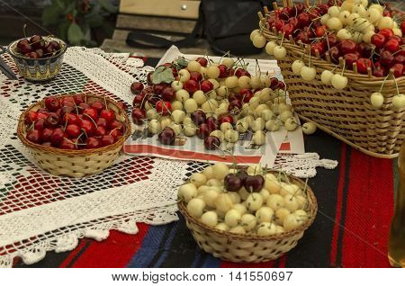 Kyustendil, Bulgaria - June 25, 2016: Feast of cherry fruit in the Kyustendil, presentment out their production raw fruit, Bulgaria. Visit of Kyustendil in summer.