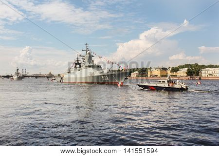 St. Petersburg, Russia - 31 July, Two military ships and boats, 31 July, 2016. Festive parade of warships on the Neva River in St. Petersburg.
