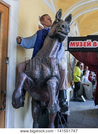 St. Petersburg, Russia - 9 April, Figure Putin on horseback, 9 April, 2016. Wax Museum Gallery large Gostiny Dvor.