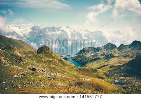 Lake and Mountains Landscape in Abkhazia with blue sky ad clouds Summer Travel serene scenic view of Greater Caucasus Range